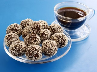 chocolate balls with almonds and cup of coffee
