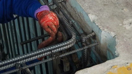 Worker connect reinforcement deform bar with binding wire.
