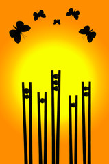 Butterflies silhouettes above flowers made from chopsticks and