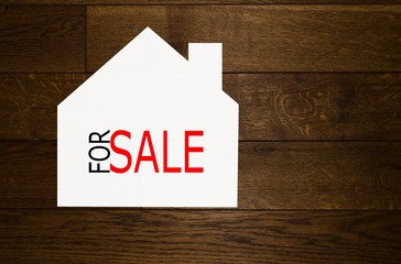 House for sale over wooden background