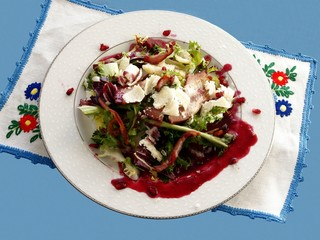 vegetable salad with pork bacon and pomegranate juice