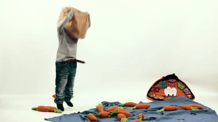 boy jumping with a bag on his head