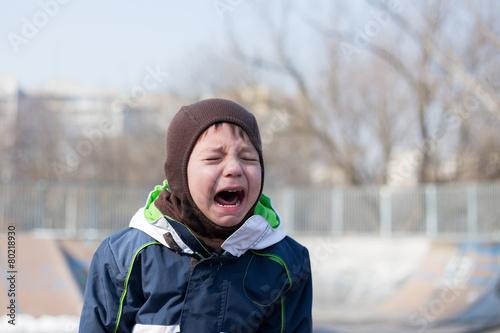 kid crying very loud in a temper tantrum - 80218930
