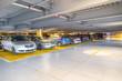 Leinwanddruck Bild - Parking garage, interior with a parked cars