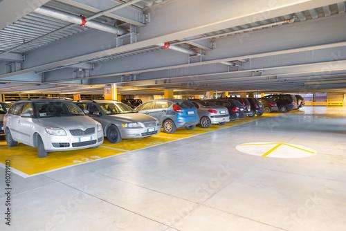 Leinwanddruck Bild Parking garage, interior with a parked cars
