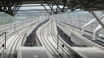 High-speed train traveling away from railway station