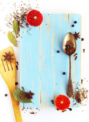 Different spices, anise, laurel, clove and others on a board