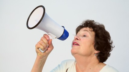 Old woman speaks in megaphone, isolated sideview closeup