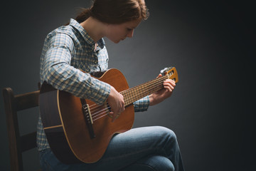 Young Musician - Woman with Guitar