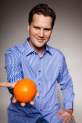 Diet and healthy nutrition. Man recommending orange