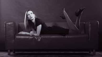 Fashion woman posing on couch