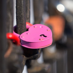 pink heart-shaped lock on  fence