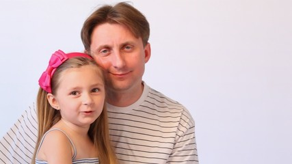 father embraces having fun and smiling daughter close up