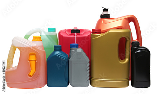 Leinwandbild Motiv Plastic bottles from automobile oils isolated on white