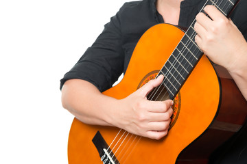 Female hands playing an acoustic guitar