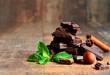 Leinwandbild Motiv Stack of chocolate slices with mint leaf,hazelnut and cinnamon.