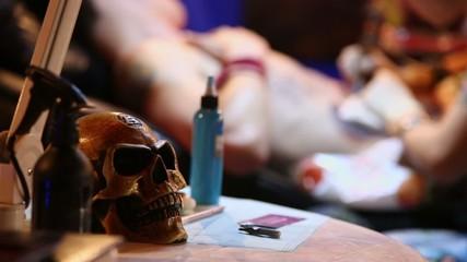Tattoo artist works during International Tattoo Convention V