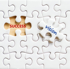 Success and vision words on jigsaw puzzle background