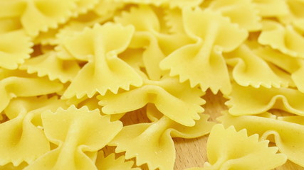 Farfalle - bow shaped pasta background in 4K UHD