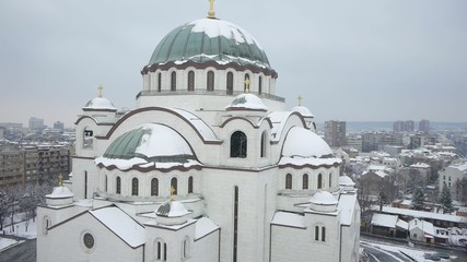 Aerial view of big orthodox church covered with snow.