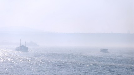 Walking ships float with tourists on gulf early in morning in fog, time lapse
