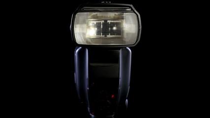 Digital camera - activating flash light in 4K UHD video.