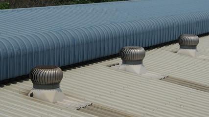 Ventilator spin on roof.camera pan.