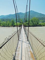 Suspension bridge across the broad river