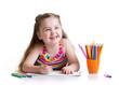 Happy little girl drawing with felt-tip pen in preschool