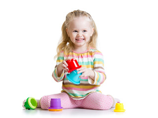 smiling child girl playing with color toys