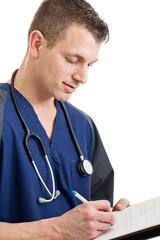 Male nurse taking notes
