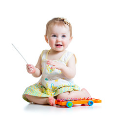 smiling child playing with musical toy