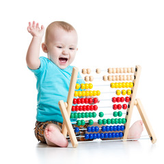 Happy baby playing with counter toy