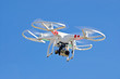 white drone hovering in blue sky - 80232373