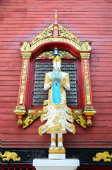 Angel sculpture on the facade of Wat Ming Mueang at Chiang Rai
