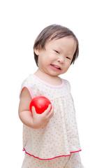 Little asian girl holding red ball over white background