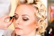 makeup of a beautiful woman in a beauty salon