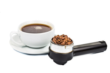 Portafilter with coffee beans and with a cup brewed espresso