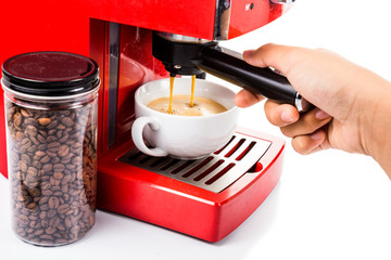 Hand brewing coffee with a red color espresso coffee machine