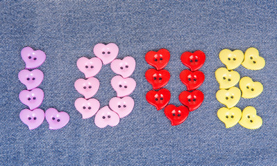Multi-colored buttons in the shape of hearts