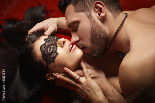 Domineering lover kisses his sexy submissive - 80234534