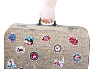hand holding a retro suitcase