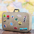retro suitcase with stikkers on the floor - 80234914