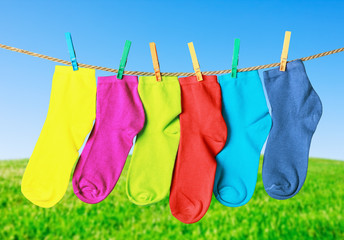 colorful socks hanging from a rope