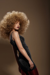 Haute Couture. Fashion Woman with Fancy Hairstyle