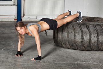 Push up exercise on a tire crossfit training