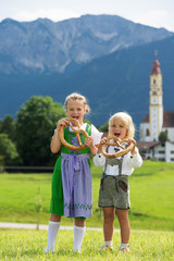 Two little children in traditional German bavarian clothes