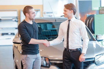 Customer and sales consultant with showroom view on the backgrou
