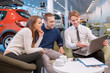 Couple communicating with the salesman in showroom - 80238121