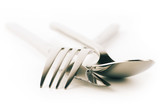 Fork, spoon and knife on white